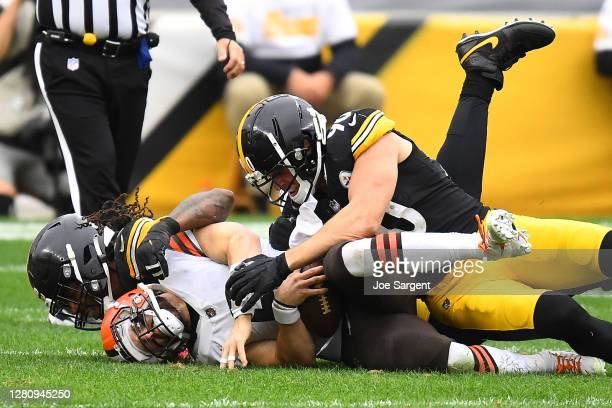 Baker Mayfield of the Cleveland Browns is sacked by Bud Dupree of the Pittsburgh Steelers during their NFL game at Heinz Field on October 18 2020 in...