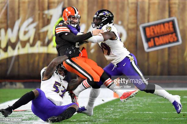 Baker Mayfield of the Cleveland Browns is tackled by Jihad Ward and Matt Judon of the Baltimore Ravens during the first quarter in the game at...