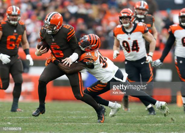 Baker Mayfield of the Cleveland Browns is tackled by Shawn Williams of the Cincinnati Bengals during the second half at FirstEnergy Stadium on...