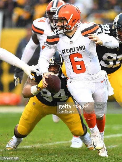 Baker Mayfield of the Cleveland Browns scrambles out of the pocket under pressure from Tyson Alualu of the Pittsburgh Steelers during the second half...