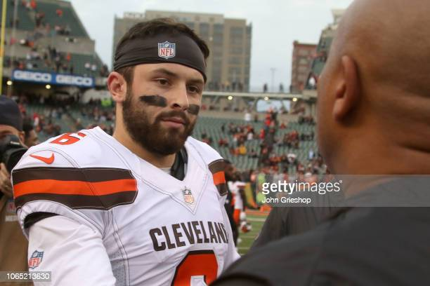 Baker Mayfield of the Cleveland Browns shakes hands with special assistant to the head coach Hugh Jackson of the Cincinnati Bengals at the end of the...