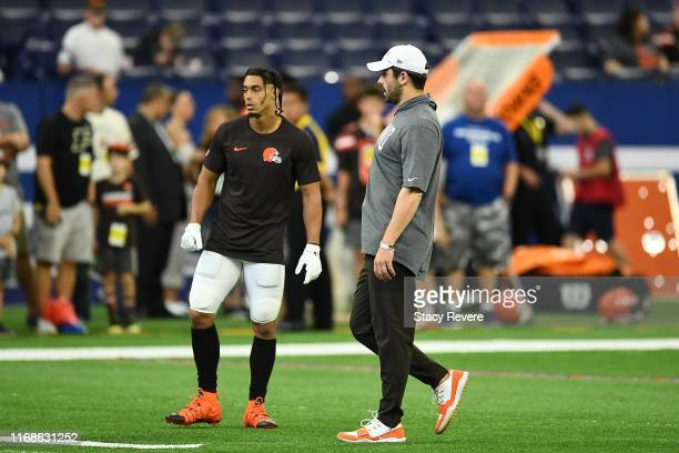 Baker Mayfield of the Cleveland Browns speaks with Damon SheehyGuiseppi prior to a game against the Indianapolis Colts at Lucas Oil Stadium on August...