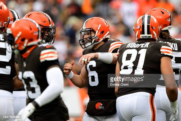 Baker Mayfield of the Cleveland Browns talks to teammates during a game against the Arizona Cardinals at FirstEnergy Stadium on October 17, 2021 in...
