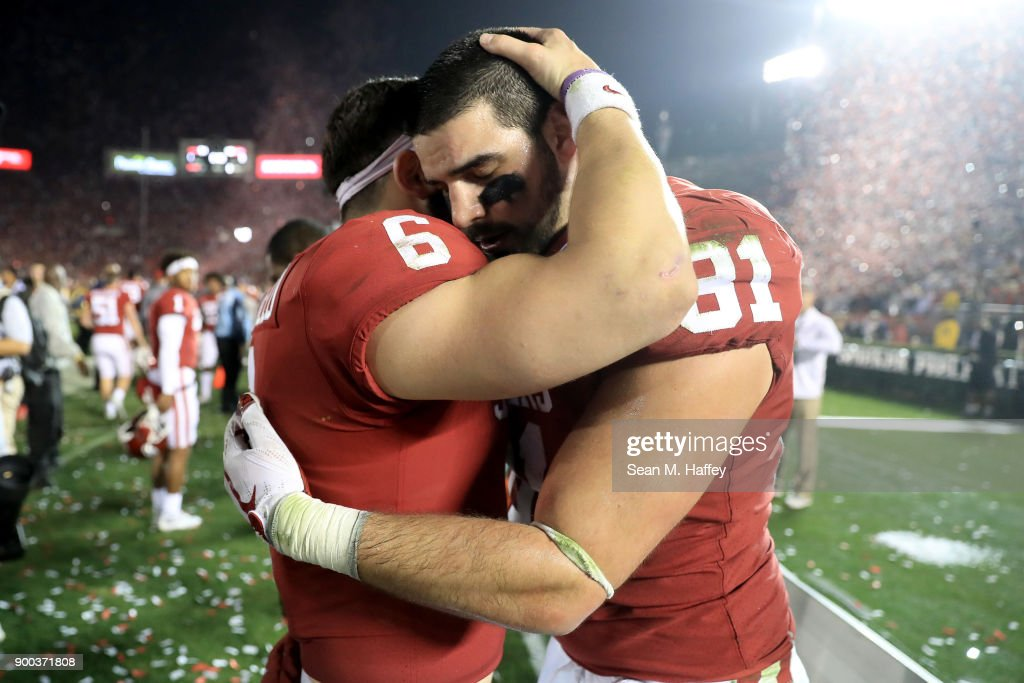Baker Mayfield #6 of the Oklahoma Sooners and Mark Andrews #81 of the Oklahoma Sooners hug after the 2018 College Football Playoff Semifinal Game against the Georgia Bulldogs at the Rose Bowl Game presented by Northwestern Mutual at the Rose Bowl on January 1, 2018 in Pasadena, California.