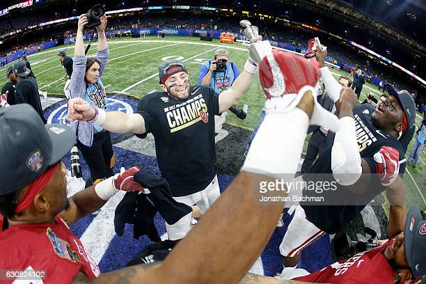 Baker Mayfield of the Oklahoma Sooners celebrates after defeating the Auburn Tigers 3519 during the Allstate Sugar Bowl at the MercedesBenz Superdome...