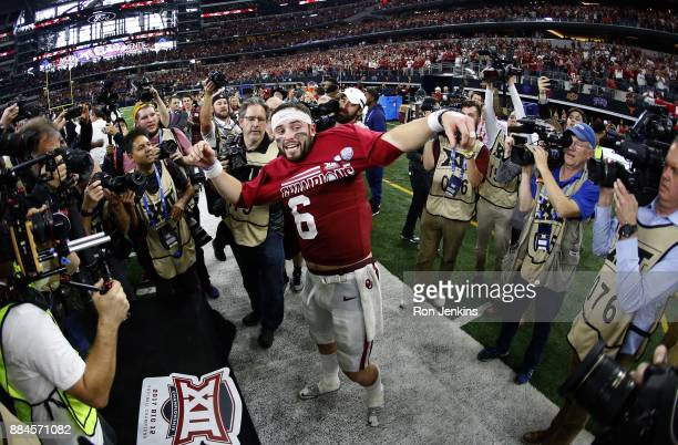 Baker Mayfield of the Oklahoma Sooners celebrates after defeating the TCU Horned Frogs 4117 in the Big 12 Championship ATT Stadium on December 2 2017...