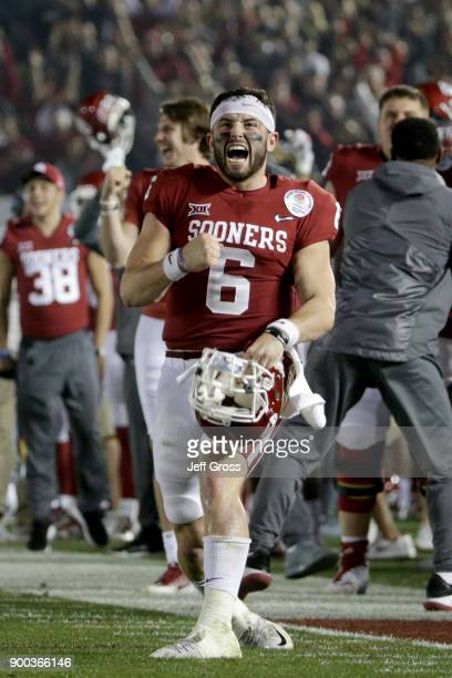 Baker Mayfield of the Oklahoma Sooners celebrates after Steven Parker of the Oklahoma Sooners scores a 46 yard touchdown because of a fumble by Sony...