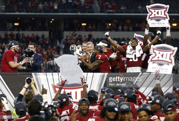 Baker Mayfield of the Oklahoma Sooners celebrates with his team after defeating the TCU Horned Frogs 4117 in the Big 12 Championship ATT Stadium on...