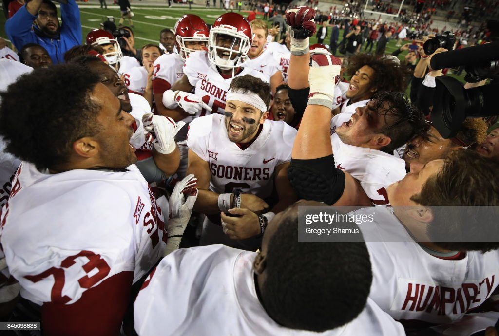 Baker Mayfield #6 of the Oklahoma Sooners (C) celebrates with teammates after defeating the Ohio State Buckeyes 31-16 at Ohio Stadium on September 9, 2017 in Columbus, Ohio.