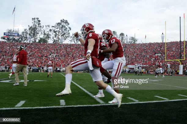 Baker Mayfield of the Oklahoma Sooners Jordan Smallwood of the Oklahoma Sooners and Erick Wren of the Oklahoma Sooners react diuring the 2018 College...