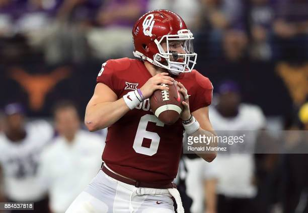 Baker Mayfield of the Oklahoma Sooners looks to pass against the TCU Horned Frogs in the second quarter during Big 12 Championship at ATT Stadium on...