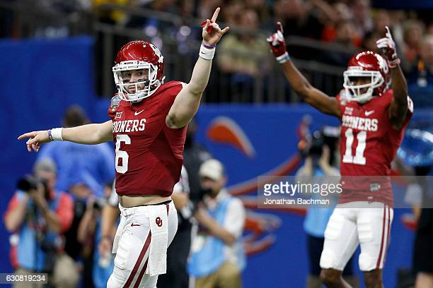 Baker Mayfield of the Oklahoma Sooners reacts after scoring a touchdown against the Auburn Tigers during the Allstate Sugar Bowl at the MercedesBenz...