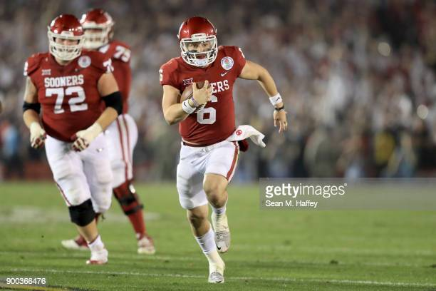 Baker Mayfield of the Oklahoma Sooners runs the ball down field in the 2018 College Football Playoff Semifinal Game against the Georgia Bulldogs at...