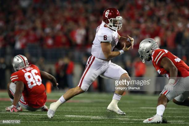 Baker Mayfield of the Oklahoma Sooners runs with the ball during the first half against the Ohio State Buckeyes at Ohio Stadium on September 9 2017...