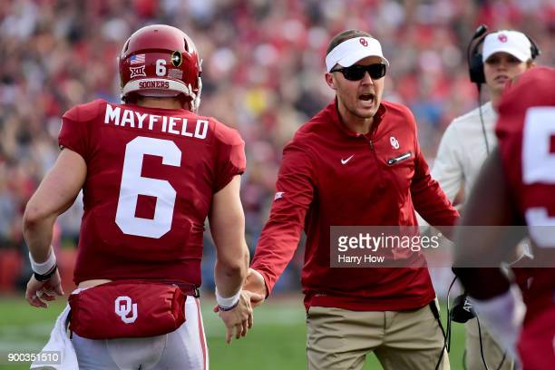 Baker Mayfield of the Oklahoma Sooners shakes hands with head coach Lincoln Riley during the 2018 College Football Playoff Semifinal Game against the...