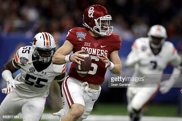 Baker Mayfield of the Oklahoma Sooners throws a pass against the Auburn Tigers during the Allstate Sugar Bowl at the MercedesBenz Superdome on...