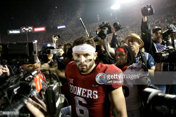 Baker Mayfield of the Oklahoma Sooners walks off the field after playing in the 2018 College Football Playoff Semifinal Game against the Georgia...