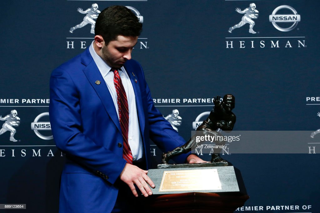 Baker Mayfield, quarterback of the Oklahoma Sooners, poses for the media after the 2017 Heisman Trophy Presentation at the Marriott Marquis December 9, 2017 in New York City.