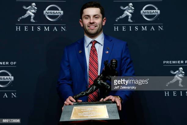 Baker Mayfield quarterback of the Oklahoma Sooners poses for the media after the 2017 Heisman Trophy Presentation at the Marriott Marquis December 9...