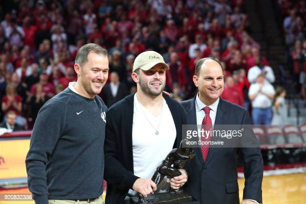 Baker Mayfield with Lincoln Riley and Joe Castiglione during a college basketball game between the Oklahoma Sooners and the Texas Longhorns on...