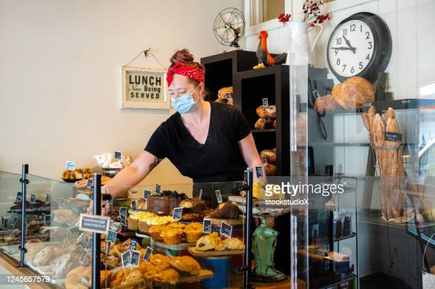 baker opening shop after the coronavirus lockdown - reopening stock pictures, royalty-free photos & images