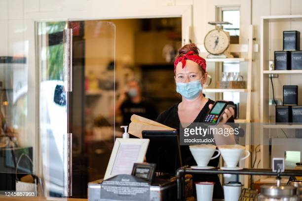baker opening shop after the coronavirus lockdown - store opening stock pictures, royalty-free photos & images