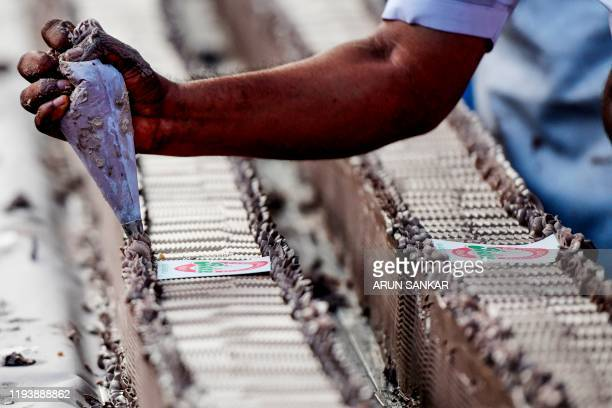 A baker or chef prepares an approximatively 65km long cake to break the Guinness World Record for the longest cake in Thrissur in south Indian state...