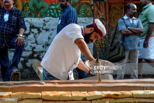 A baker prepares an approximatively 65km long cake as a attempt aim to break the Guinness World Record for the longest cake in Thrissur in south...