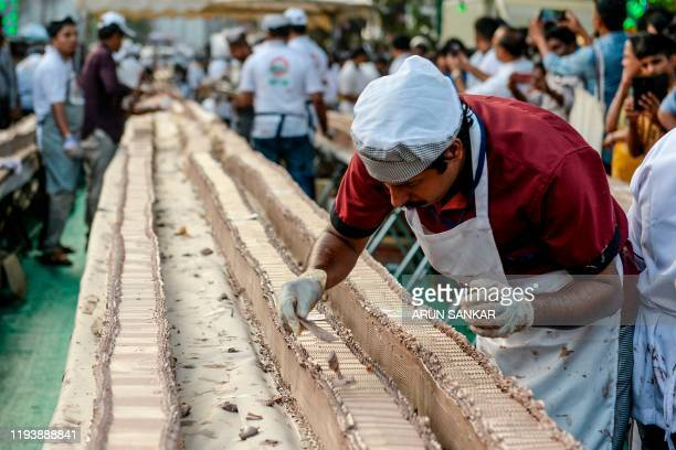 TOPSHOT A baker prepares an approximatively 65km long cake as a attempt aim to break the Guinness World Record for the longest cake in Thrissur in...