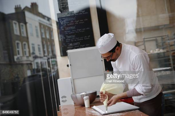 A baker prepares meringues in a patisserie on Northcote Road on March 7 2017 in London England Business premises are to be revalued from April 1 In...