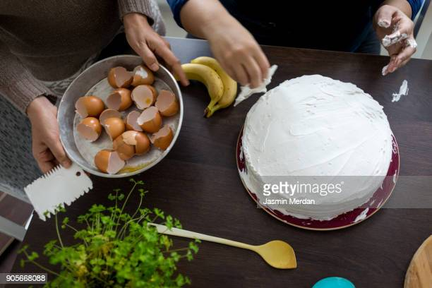 baker preparing cake - decorating a cake stock pictures, royalty-free photos & images