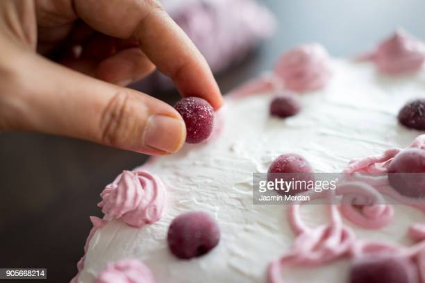 Baker preparing cake