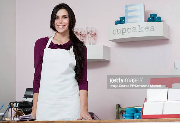 Baker smiling behind counter