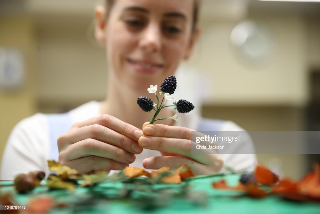 Baker Sophie Cabot Puts The Finishing Touches To Cake Decorations For News Photo Getty Images