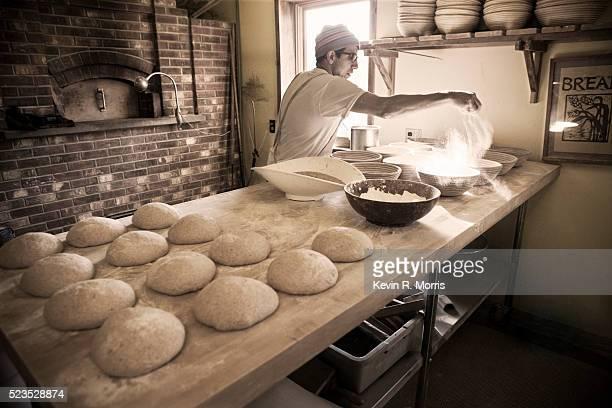 Baker spreading flour