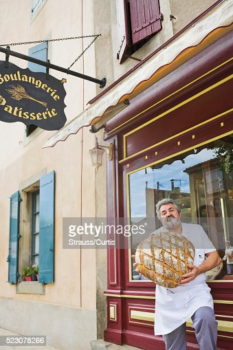 Baker standing in front of shop