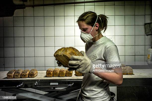 A baker stores bread after its baking on December 27 2012 in a bakery of Ecole en Bauges French Alps AFP PHOTO / JEFF PACHOUD