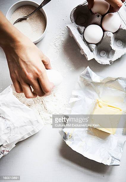 Baker with eggs, flour and butter