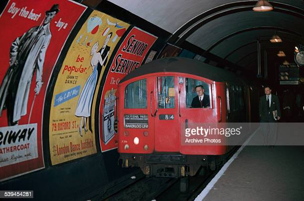 A Bakerloo line train pulls into an Underground station in London England circa 1960