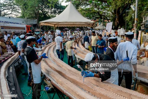 Bakers and chefs prepare an approximatively 65km long cake as a attempt aim to break the Guinness World Record for the longest cake in Thrissur in...