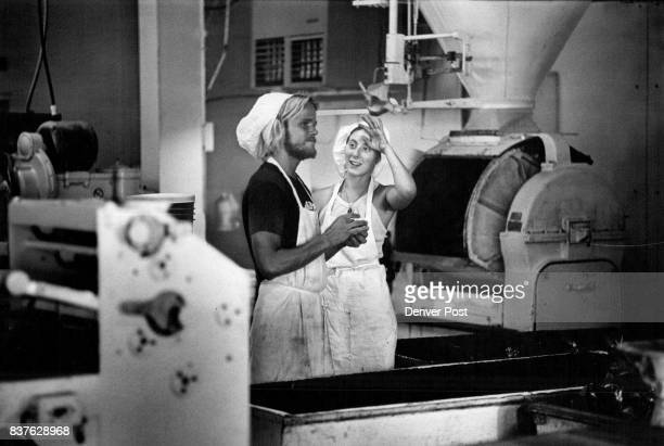 Bakers Greg Bethel and Amena fram take a break at the ' Bread Shop ' The four kinds of loaves from the shop's ovens made only modest inroads on store...
