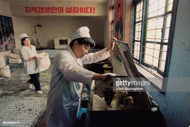 Bakers in a bakery in Hwasan On the wall a propaganda poster