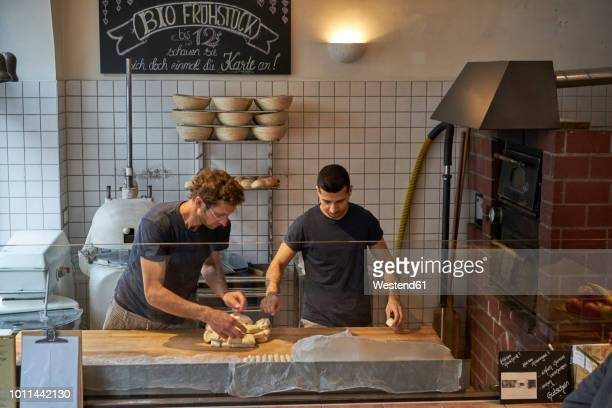 Bakers in bakery preparing fresh pretzls