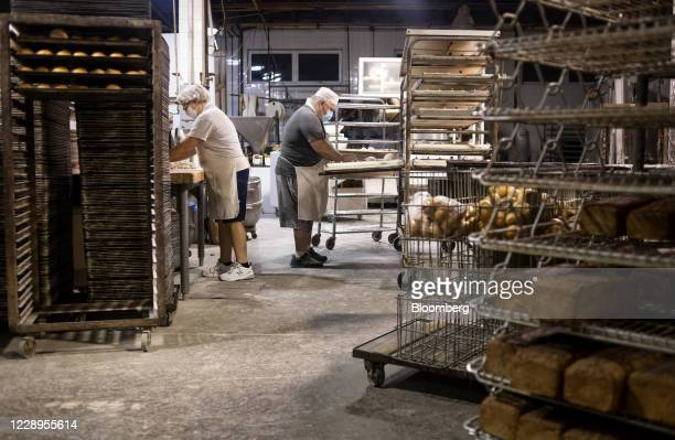 Bakers knead piles of sourdough dough inside of Reineckers Bakery in Macedonia Ohio US on Wednesday Oct 7 2020 A weekly measure of US consumer...