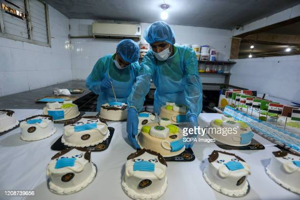 Bakers making cakes of different shapes during the corona virus pandemic Palestinian bakers make different shapes of cakes relating to Covid19...