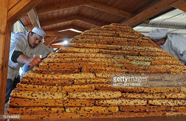 Bakers of the Dresden's 'Association for the Protection of Stollen' work on a giant fruit loave in Dresden, eastern Germany, on December 2, 2012. The...