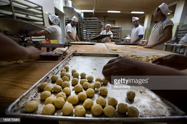 Bakers prepare dough for pan de muerto at La Ideal bakery in Mexico City Mexico on Thursday Oct 24 2013 The pan de muerto or bread of the dead is a...