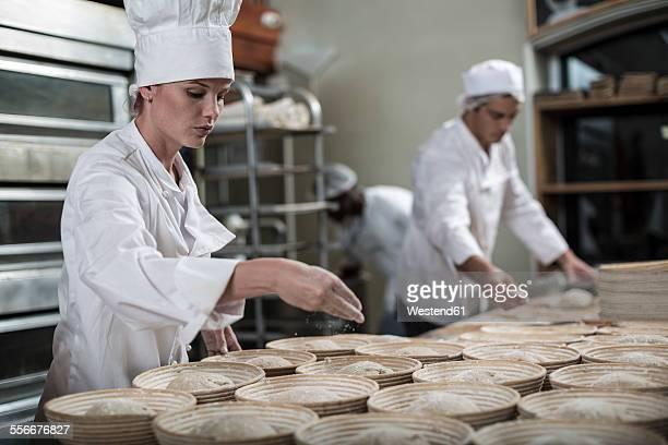 Bakers preparing ceramic bowls for baking bread
