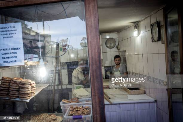 Bakers work in a shop in the Old City of Mardin on May 11 2018 in Mardin Turkey Mardin a historical city in South Eastern Turkey is situated on top...