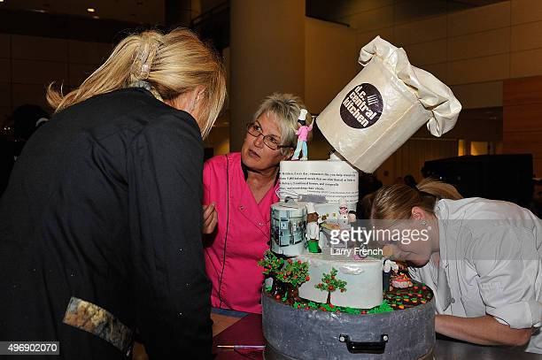 Bakers work on a cake at DC Central Kitchen's Capital Food Fight at the Ronald Reagan Building on November 12 2015 in Washington DC